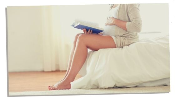 woman learning a language as a hobby whilst pregnant