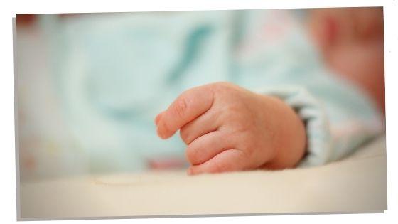 Newborn baby boy hand