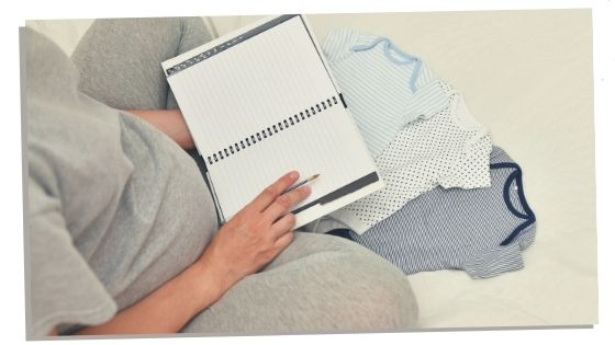 Woman holding her second baby checklist
